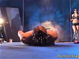 extraordinary fetish display on stage