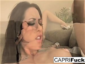 Capri loves to use various playthings on her raw cock-squeezing muff